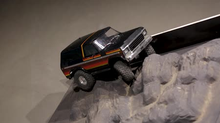 auta : The car is running over an offroad terrain track. Free time. Children and adults concept. Hoby. Toys.