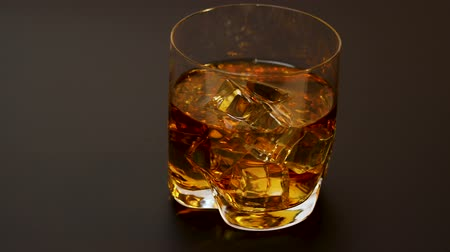 bourbon whisky : Beautiful view of glass of whiskey with ice on dark background. Beautiful backgrounds. Alcohol concept.