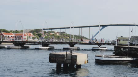 Gorgeous view of the moving pontoon Queen Emma Bridge across St. Anna Bay. Willemstad. Curacao. 19092019