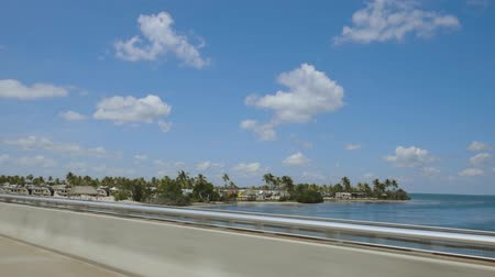Highway to Key West Florida. View of old abandoned bridge and coast line of Atlantic ocean on blue sky with numerous clouds background. Florida USA