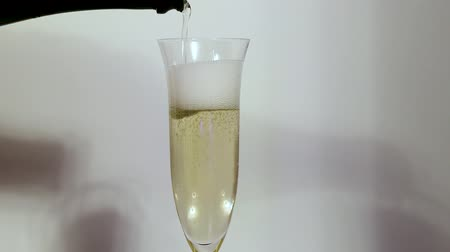 Champagne being poured into a tumbler glass on background. Beautiful backgrounds. Alcohol concept. Wideo