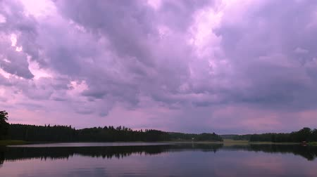 гром : Gorgeous summer evening. Crystal clear mirror water surface. Sky covered with heavy clouds.