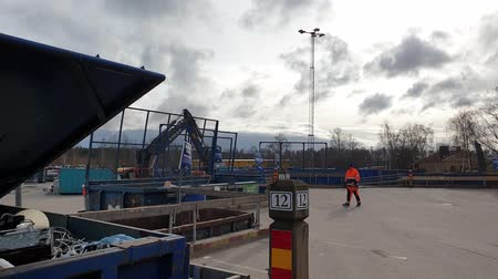 nakládané : Slow motion. Beautiful overview of waste recycling station. Europe Sweden Enkoping. Dostupné videozáznamy