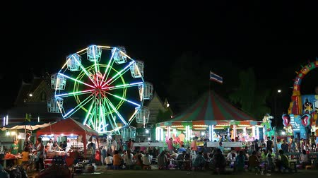 tekerlekler : Ferris Wheel in night festival ,Thailand Stok Video