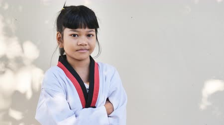 sztuki walki : Portrait of asian children standing alone in taekwondo suit
