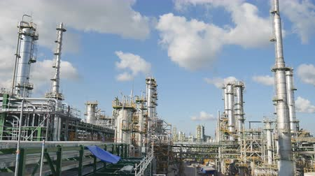 rafineria : Oil Refinery plant with blue sky , 4K video panning