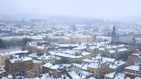 ciclone : Snow Storm in Old Europe City. Heavy Snow falling in the middle of winter.
