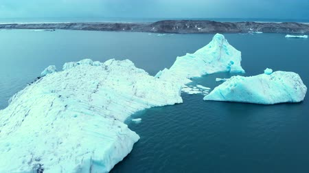 Антарктика : Antarctica Melting Blue Water Iceberg Aerial View. Antarctic Ocean Environment.