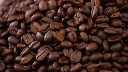 grãos de café : Dark Coffee rotating on board Coffee beans clouse up Beautiful coffee beans. Vídeos