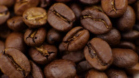 roaster : Dark Coffee rotating on board Coffee beans clouse up Beautiful coffee beans. Stock Footage