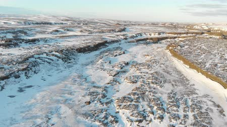 antarktida : Snow Covered Rock. Aerial Winter Landscape in Iceland Dostupné videozáznamy