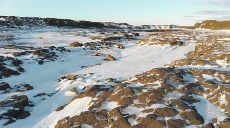 genel bakış : Snow Covered Rock. Aerial Winter Landscape in Iceland Stok Video