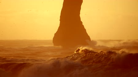 Mountaine peak in Ocean. Rock at Black Beach. Iceland.