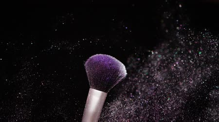 Make Up Brush with colored Powder at black background Slow Motion Concept Стоковые видеозаписи