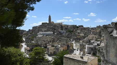 sicilian : Panoramic view of Matera, typical stones Sassi di Matera under blue sky with moving clouds. Stock Footage