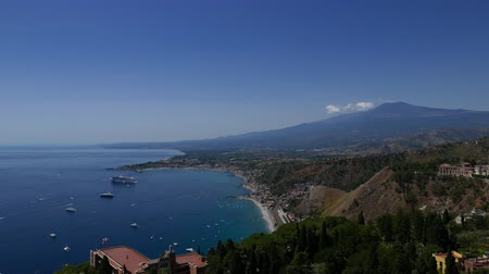 sicilian : The coast of Taormina in Sicily with Mount Etna in the background, Italy
