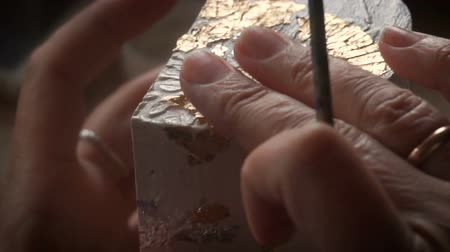 restaurálás : Applying Gold Leaf. The Artist decorates the box with a sheet of gold. Restoration of the interior Stock mozgókép