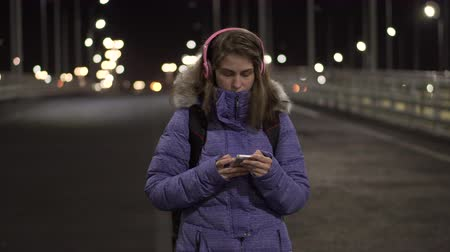 deserted : Attractive Woman using Mobile Phone During Walk on Streets of Night Town