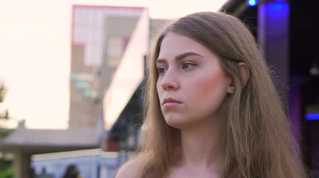 Portrait of a pensive girl near a shop window Stockvideo