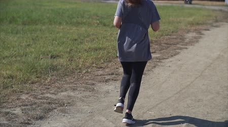 Athletic girl jogging on the sandy shore