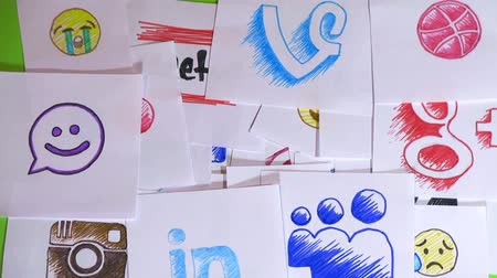 bird list : Placing pieces of paper with the logo of social networking. A variety of social networks and emoticons. Stop motion