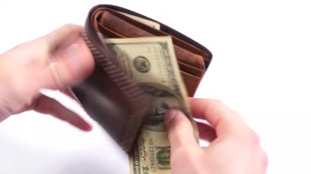 stash : Taking Money Out of a Purse. The man opens a leather purse and pulls out a dollar bill