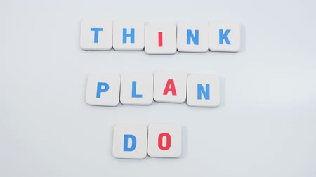 the conception : Moving letters forming words THINK, PLAN, DO. Motivational phrase. Stop motion Stock Footage