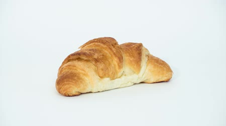 kruvasan : Eating Croissant with filling red colour. Croissant isolated on white background. Stop motion