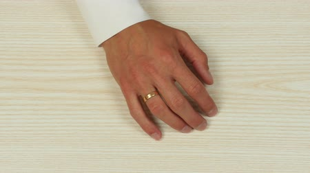 divorcement : Hands of a man taking a ring off his finger. Top view.