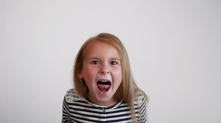 holler : Closeup girl screaming into the camera Stock Footage