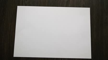 Top view of falling blank white sheet. Close up