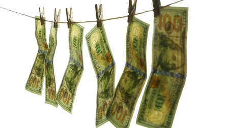 varal : Dollar banknotes hang on a rope with clothespins. The concept of dirty money