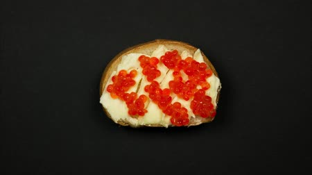 Preparation of a sandwich with red caviar. Stop motion Stock Footage