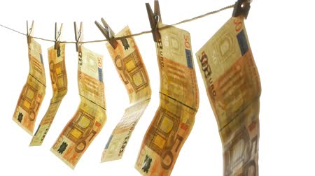 Euro money hangs on a rope attached with clothespins Stock Footage