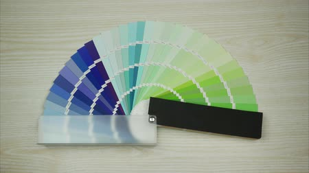Color Swatches Book with Rainbow Sample. Stop motion Stock Footage