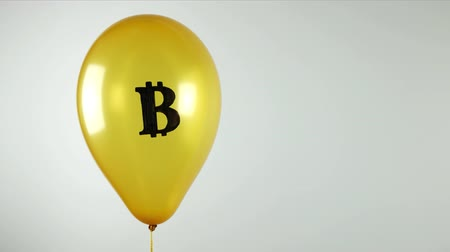 The concept of unreliability crypto currency. Yellow balloon with bitcoin logo