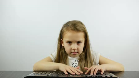 An impatient girl pushes the keyboard buttons Stock Footage