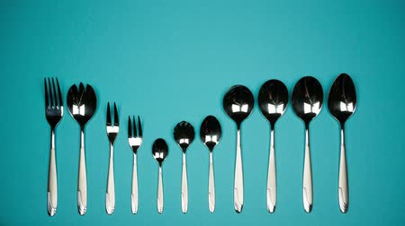A number of forks and spoons for different dishes