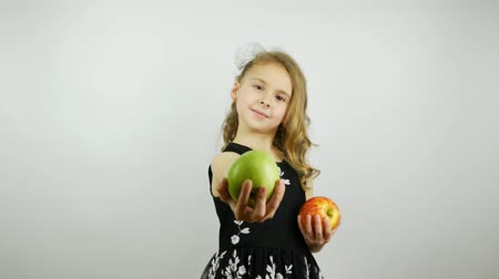 fructose : The girl wonders which apple to choose. Offering a green apple