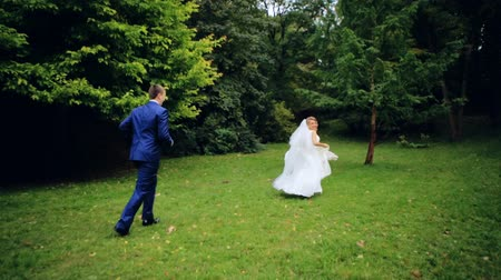 mese : the couple running in the park shot in slow motion  close up Stock mozgókép