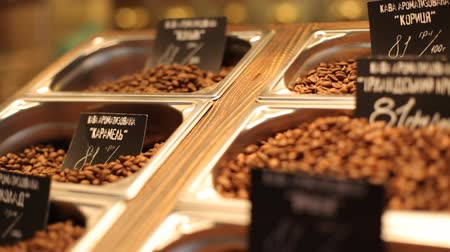 oldódó : . Different kinds of coffee with a great  variety of assortment and varient prices putten on a wooden plate.