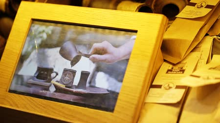 képek : 3D picture in a wooden frame illustrating hands of a woman serving a cup of coffee with respect of old tradition of making tasty aroma coffee drink.