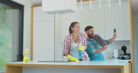 myjnia : Man and woman as a professional cleaners in uniiform having fun during the work on the kitchen.