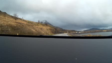csendes : Reykjavik Iceland, May 12 2018: Editorial video driving alongside Reykjavik countryside showing the Icelandic countryside and the beautiful mountains