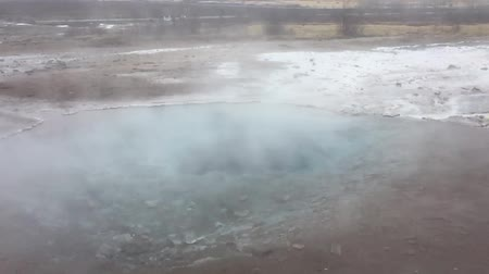 strokkur : SLOW MOTION Steam raising from a pond in Iceland that is heated geothermally in slow motion