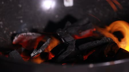 popel : Burning coal. Close up of red hot coals glowed in the stove