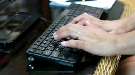 papelada : HD Dolly: Woman working and tryping keyboard, close up hand Stock Footage