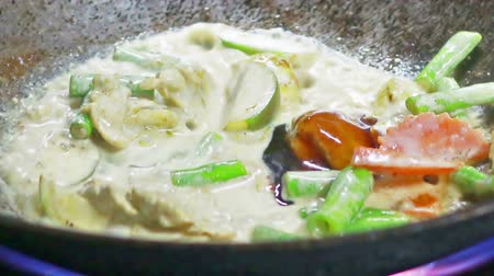 food preparation : HD footage, Close up chefs cooking eggplant thai food, green curry chicken in kitchen