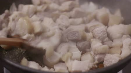 pivoting : HD footage close up of Frying pork with salt in a pan