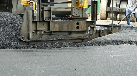 A road crew repairs the city street in Seattle Stock Footage